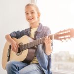 Teenage girl having guitar lessons at Buderim with Christensen's