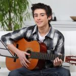 Teenage boy having guitar lessons at Buderim with Christensen's